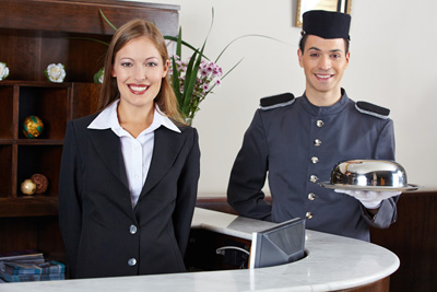 How should you select seasonal staff for your property?